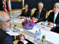 Iran's Foreign Minister Mohammad Javad Zarif (L) meets with US Secretary of State John Kerry (R) during talks between the foreign ministers of the six powers negotiating with Tehran on its nuclear program, in Vienna, on July 13, 2014. Big difference remained in nuclear talks between world powers and Iran …