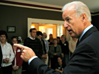 U.S. Sen. Joe Biden, D-Del., talks to people at a house party in Concord, N.H., Sunday, Dec. 17, 2006. Biden is considered a possible 2008 presidential candidate. (AP Photo/Jim Cole)