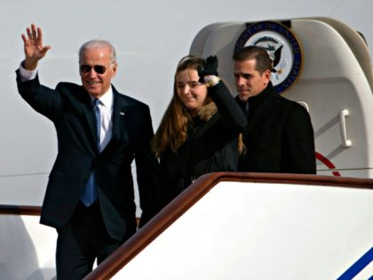 US Vice President Joe Biden waves as he walks out of Air Force Two with his granddaughter, Finnegan Biden (C) and son Hunter Biden (R) upon their arrival in Beijing on December 4, 2013. Biden arrived in Beijing on Decmber 4 amid rising friction over a Chinese air zone, needing …