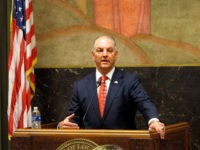 Gov. John Bel Edwards talks with supporters on the final day of the special session on taxes that he called to raise money for next year's budget, on Monday, June 4, 2018, in Baton Rouge, La. (AP Photo/Melinda Deslatte)