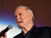 "British actor John Cleese delivers a speech as he receives the 'Honorary Heart Of Sarajevo' award for his ""extraordinary contribution"" to film during the 23rd Sarajevo Film Festival late on August 16, 2017. / AFP PHOTO / ELVIS BARUKCIC (Photo credit should read ELVIS BARUKCIC/AFP/Getty Images)"