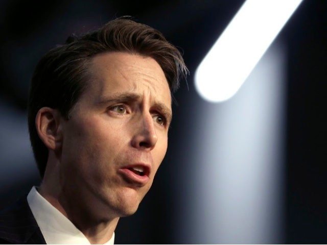 Republican Senate candidate Josh Hawley waves as he comes onto the stage during a rally hosted by the American Conservative Union Friday, Nov. 2, 2018, in Kansas City, Mo. Hawley is challenging Missouri Democratic Sen. Claire McCaskill. (AP Photo/Charlie Riedel)
