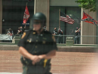 The Honorable Sacred Knights of Indiana and affiliated members hold a rally at Courthouse Square on May 25, 2019 in Dayton, Ohio. The members were protected by two barricade fences and a multitude of police officers. Around 1,000 counter demonstrators came to protest the Indiana based white supremacist group of …