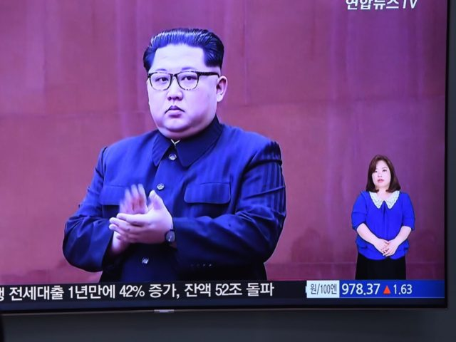 A man watches a television news screen showing North Korean leader Kim Jong Un at a railway station in Seoul on May 16, 2018. - North Korea threatened on May 16, to cancel the forthcoming summit between leader Kim Jong Un and President Donald Trump if Washington seeks to push …