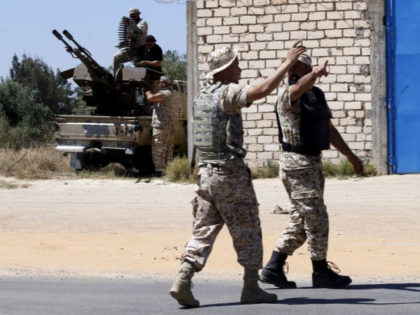 Fighters loyal to the internationally-recognised Government of National Accord (GNA) hold a position with fellow fighters during clashes with forces loyal to strongman Khalifa Haftar, in Espiaa, about 40 kilometres (25 miles) south of the Libyan capital Tripoli on April 29, 2019. - Fierce fighting for control of Libya's capital …