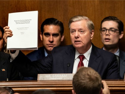 """US Senator Lindsey Graham holds the Mueller report as US Attorney General William Barr prepares to testify before the Senate Judiciary Committee on """"The Justice Department's Investigation of Russian Interference with the 2016 Presidential Election"""" on Capitol Hill in Washington, DC, on May 1,2019. (Photo by NICHOLAS KAMM / AFP) …"""