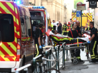 TOPSHOT - Emergency workers stretcher a woman to a waiting ambulance after a suspected package bomb blast along a pedestrian street in the heart of Lyon, southeast France, the local prosecutors' office said on May 24, 2019. - Several people were wounded by a suspected package bomb blast on a …