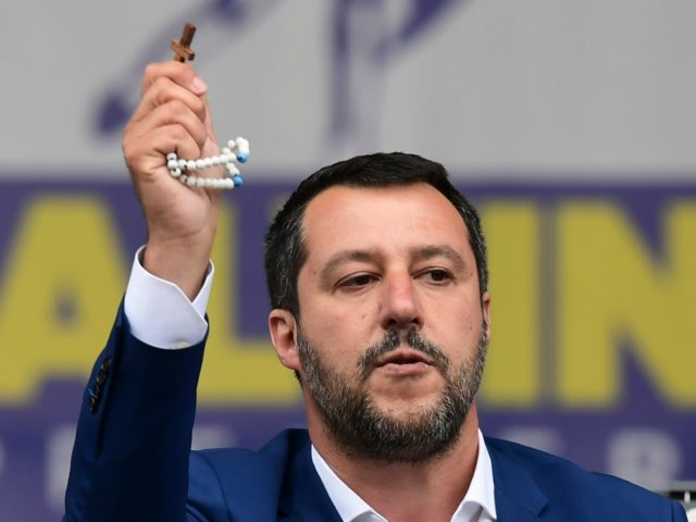 Italian Deputy Prime Minister and Interior Minister Matteo Salvini (C) delivers a speech holding a rosary during a rally of European nationalists ahead of European elections on May 18, 2019, in Milan. - The Milan rally hopes to see leaders of 12 far-right parties marching towards their conquest of Brussels …