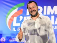 "Italian Deputy Prime Minister and Interior Minister Matteo Salvini gives a ""thumbs up"" during a press conference in the Lega headquarters in northern Milan following the results of the European parliamentary elections, on May 27, 2019. - Matteo Salvini's anti-migrant League party won the most votes on May 26 in …"