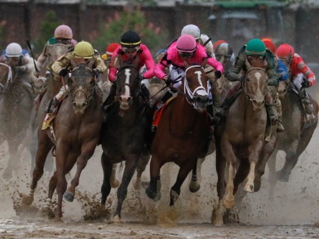 Luis Saez riding Maximum Security, second from right, goes around turn four with Flavien Prat riding Country House, left, Tyler Gaffalione riding War of Will and John Velazquez riding Code of Honor, right, during the 145th running of the Kentucky Derby horse race at Churchill Downs Saturday, May 4, 2019, …