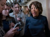 Rep. Maxine Waters, D-Calif., chair of the House Committee on Financial Services, is asked by reporters about comments by Rep. Rashida Tlaib, D-Mich., who used profanity to describe President Donald Trump and call for his impeachment, at the Capitol in Washington, Friday, Jan. 4, 2019. (AP Photo/J. Scott Applewhite)
