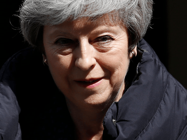 Britain's May stands by promise to resign after phase one of Brexit