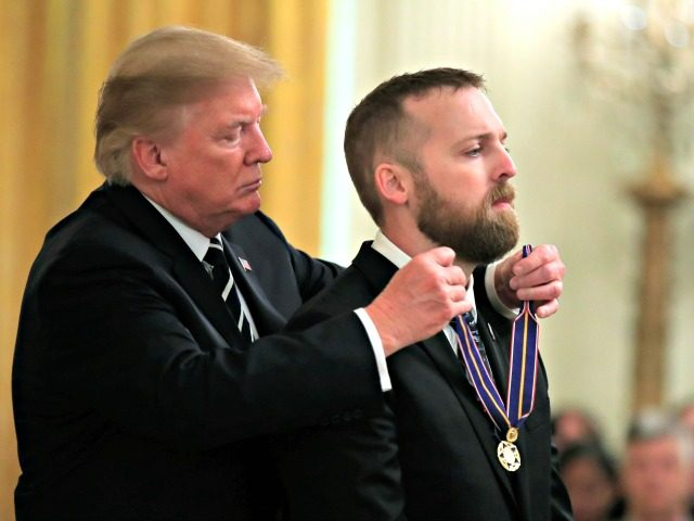 President Donald Trump awards Senior Trooper Nicholas Cederberg of the Oregon State Police, the Public Safety Officer Medal of Valor during a ceremony in the East Room of the White House in Washington, Wednesday, May 22, 2019. (AP Photo/Manuel Balce Ceneta)