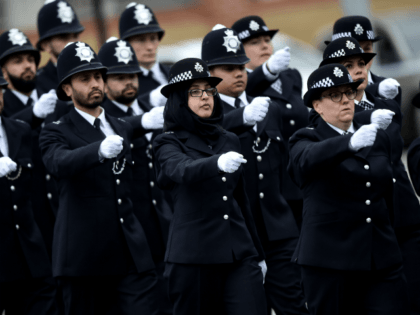 LONDON, ENGLAND - APRIL 21: New Police recruits take part in a passing-out parade at the Metropolitan Police Academy at Peel House, Hendon on April 21, 2017 in London, England. (Photo by Hannah McKay - WPA Pool / Getty Images)