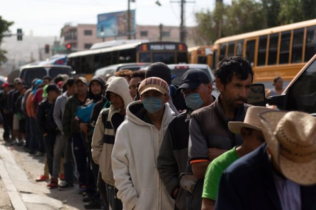 Migrants Walk Across Border