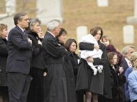 "Shannon Spann, carrying her infant son Jake, follows the coffin containing the body of her husband, CIA agent Johnny ""Mike"" Spann, during a full honors funeral December 10, 2001 at Arlington National Cemetery in Virginia. Spann, an agent of the Central Intelligence Agency who was killed during a prison uprising …"