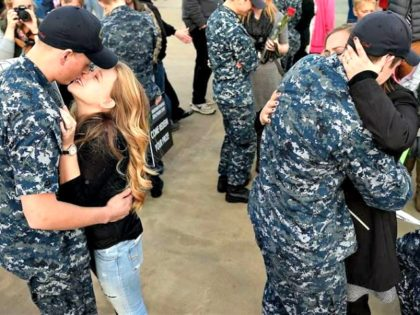 Military families reunited last month at a Navy submarine base in Groton, Connecticut, following a deployment. Laws recently passed in all states were aimed at making it easier for military spouses to stay in their career as their families move from state to state.