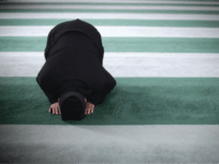 LONDON, ENGLAND - FEBRUARY 18: A Muslim man prays at Baitul Futuh Mosque in Morden on February 18, 2011 in London, England. Around five thousand Muslim men and women converged at the mosque today, which is Western Europe's largest, to Unite against Extremism and pay vigil following a series of …