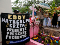 "A sign reads ""Eddy, Matagalpa shouts present, present, present"" during the burial of Nicaraguan-US political prisoner Eddy Montes Praslin, killed in a riot in La Modelo maximum security prison, in Matagalpa, about 124 km southeast of Managua, on May 19, 2019. (Photo by INTI OCON / AFP) (Photo credit should …"