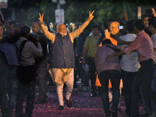 Indian Prime Minister Narendra Modi and Bharatiya Janata Party (BJP) President Amit Shah greet supporters on arrival at the party headquarters in New Delhi, India, Thursday, May 23, 2019. Modi's Hindu nationalist party claimed it won reelection with a commanding lead in Thursday's vote count, while the head of the …