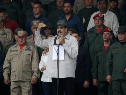 CARACAS, VENEZUELA - APRIL 13: Venezuela's President Nicolas Maduro speaks during a military parade to commemorate the Day of the Bolivarian Militias, the Armed People and the April Revolution at Los Proceres on April 13, 2019 in Caracas, Venezuela. Civil militia were created by Hugo Chavez in 2002 during a …