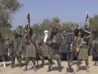 This Friday Oct. 31, 2014 image taken from video by Nigeria's Boko Haram terrorist network, the leader of Nigeria's Islamic extremist group Boko Haram, center, has denied agreeing to any cease-fire with the government and said Friday more than 200 kidnapped schoolgirls all have converted to Islam and been married …