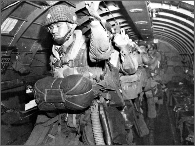 US paratroopers fix their static lines before a jump over Normandy on D-Day.AP Photo/U.S. Army Signal Corps