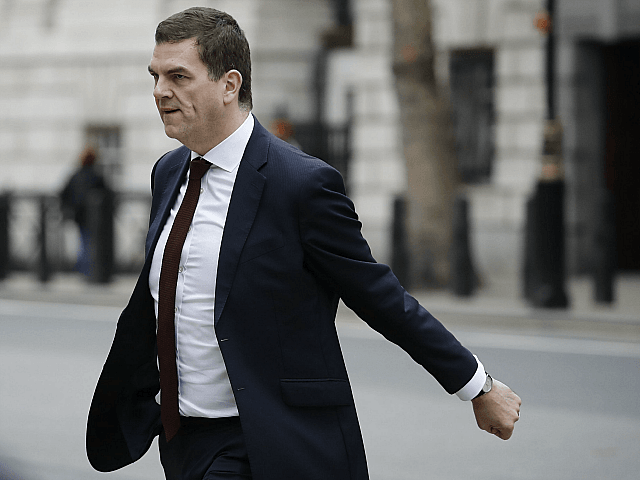 "Britain's chief Brexit negotiator Olly Robbins leaves the Cabinet Office on Whitehall in London on March 22, 2019. - Prime Minister Theresa May returned to Britain vowing to make ""every effort"" to win over MPs opposed to her EU divorce deal, hours after securing a delay to Brexit from bloc …"