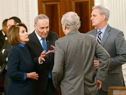 (L-R) U.S. House Minority Leader Nancy Pelosi (D-CA), Senate Minority Leader Chuck Schumer (D-NY), Senate Minority Leader Mitch McConnell (R-KY) and House Majority Leader Kevin McCarthy (R-CA) talk at a reception held by President Donald Trump for House and Senate Republican and Democratic leaders in the State Dining Room of …