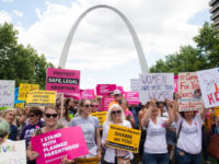 Thousands of demonstrators march in support of Planned Parenthood and pro-choice as they protest a state decision that would effectively halt abortions by revoking the license of the last center in the state that performs the procedure, during a rally in St. Louis, Missouri, May 30, 2019. (Photo by SAUL …