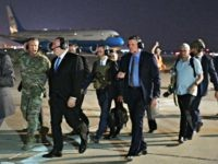 US Secretary of State Mike Pompeo (2nd L) and Lt General Paul LeCamera (L) make their way to board a helicopter in Baghdad on May 7, 2019. - Pompeo is scheduled to meet with the Iraqi prime minister and president. (Photo by MANDEL NGAN / POOL / AFP) (Photo credit …