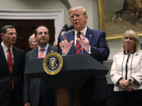 U.S. President Donald Trump speaks as Secretary of Health and Human Services Alex Azar (2nd L), Sen. John Barrasso (R-WY) (L) and Sen. Bill Cassidy (R-LA) (R) listen during a Roosevelt Room event at the White House May 9, 2019 in Washington, DC. The Trump administration is requiring drug manufacturers …