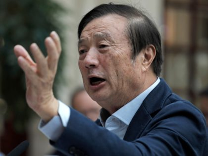 In this Tuesday, Jan. 15, 2019, file photo, Ren Zhengfei, founder and CEO of Huawei, gestures during a round table meeting with the media in Shenzhen city, south China's Guangdong province. The founder of network gear and smart phone supplier Huawei Technologies said the tech giant would reject requests from …