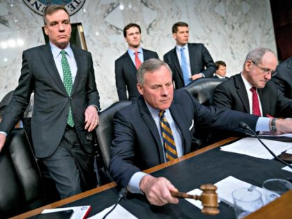 Senate Intelligence Chairman Richard Burr, R-N.C., center, accompanied by Committee Vice Chairman Mark Warner, D-Va., left, and Sen. Jim Risch, R-Idaho, right, gavel in for a second panel following testimony from Homeland Security Secretary Kirstjen Nielsen and former Homeland Security Secretary Jeh Johnson at a Senate Intelligence Committee hearing on …