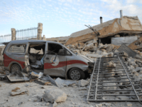 A picture taken on May 5, 2019 shows destruction at the entrance of a hospital in the village of Kafr Nabl, south of the jihadist-held Syrian province of Idlib. - Two hospitals in the Syrian province of Idlib, were put out of service by Russian air strikes according to the …
