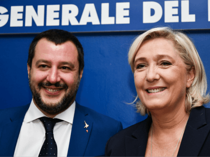 "Italy's Interior Minister, Matteo Salvini (L) and leader of France's far-right National Rally (RN) party, Marine Le Pen pose upon their arrival to attend a debate on the theme ""Economic growth and social prospects in a Europe of Nations"" on October 8, 2018 at the headquarters of the Unione Generale …"