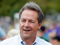 Montana Gov. Steve Bullock walks down the main concourse during a visit to the Iowa State Fair, Thursday, Aug. 16, 2018, in Des Moines, Iowa. (AP Photo/Charlie Neibergall)