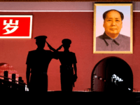 Chinese Paramilitary police officers salut each other as they stand guard below a portrait of the late leader Mao Zedong in Tiananmen Square on June 4, 2014 in Beijing, China. Twenty-five years ago on June 4, 1989 Chinese troops cracked down on pro-democracy protesters and in the clashes that followed …