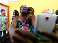 SYDNEY, AUSTRALIA - MARCH 04: Members of the Tiwi Islands transgender community prepare ahead of the Sydney Gay and Lesbian Mardi Gras parade on March 4, 2017 in Sydney, Australia. After a successful crowd funding campaign, a group of 30 transgender women from the remote Northern Territory Tiwi Islands travelled …