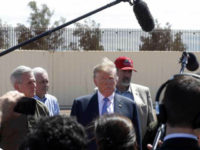 President Trump visits a new section of the U.S.-Mexico border in April 2019.