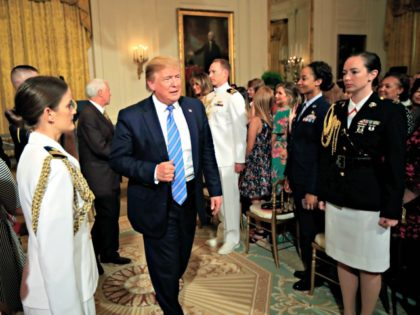 President Donald Trump leaves the East Room during a celebration of military mothers with first lady Melania Trump at the White House in Washington, Friday, May 10, 2019. (AP Photo/Manuel Balce Ceneta)