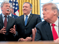 "From left, National Security Adviser John Bolton, accompanied by Secretary of State Mike Pompeo, and President Donald Trump, speaks before Trump signs a National Security Presidential Memorandum to launch the ""Women's Global Development and Prosperity"" Initiative in the Oval Office of the White House in Washington, Thursday, Feb. 7, 2019. …"