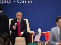 """US President Donald Trump (L) gestures during a business leaders event with China's President Xi Jinping inside the Great Hall of the People in Beijing on November 9, 2017. Donald Trump urged Chinese leader Xi Jinping to work """"hard"""" and act fast to help resolve the North Korean nuclear crisis, …"""