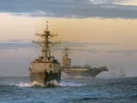 PACIFIC OCEAN - JANUARY 26: In this handout image provided by the U.S. Navy, ships assigned to USS Abraham Lincoln Strike Group, trail behind the guided missile destroyer USS Momsen (DDG 92) during a straight transit exercise January 26, 2008 at sea. Ships and aircraft assigned to Carrier Strike Group …