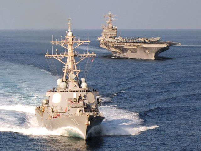 GULF OF OMAN - NOVEMBER 23, 2010: In this handout provided by the U.S. Navy, the guided-missile destroyer USS Ross and the aircraft carrier USS Abraham Lincoln cruise in formation November 23, 2010 in the Gulf of Oman. Ross was one of two destroyers that, according to published reports, fired …