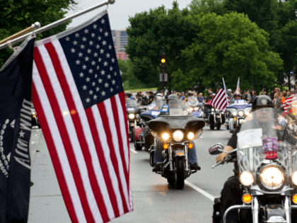 Participants in the Rolling Thunder annual motorcycle rally, ride past Constitution Avenue in Washington DC, May 28, 2017. Motorcyclists are in Washington for the traditional annual Rolling Thunder ahead of Memorial Day, May 29. / AFP PHOTO / Jose Luis Magana (Photo credit should read JOSE LUIS MAGANA/AFP/Getty Images)