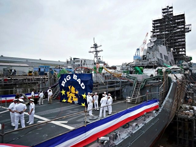 The USS John S. McCain under repair at a dry dock is seen after a rededication ceremony for at the U.S. Naval base in Yokosuka, southwest of Tokyo, Thursday, July 12, 2018. Navy Secretary Richard Spencer dedicated one of two destroyers involved in fatal accidents in the Pacific last year …