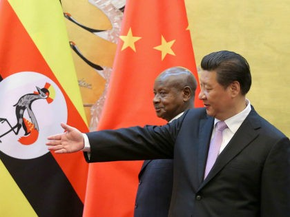 BEIJING, CHINA - MARCH 31: Ugandan President Yoweri Kaguta Museveni (L) and Chinese President Xi Jinping (R) attend a signing ceremony in the Great Hall of the People on March 31, 2015 in Beijing, China. (Photo by Feng Li - Pool/Getty Images)