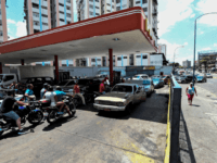 "People queue at a gas station in Caracas, on March 10, 2019, during a massive power outage. - National Assembly leader Juan Guaido said Sunday he will ask the Venezuelan legislature to declare a ""state of alarm"" in order to request international aid amid a massive power outage. (Photo by …"