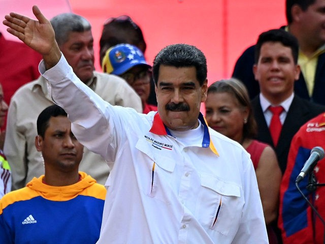 Venezuela's President Nicolas Maduro waves during a rally in front of Miraflores Presidential Palace in Caracas on May 20, 2019. - Embattled Venezuelan President Nicolas Maduro rallied hundreds of his supporters in Caracas on Monday to mark the anniversary of his controversial re-election in May 2018 polls widely denounced as …